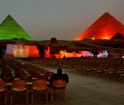 GIZA, EGYPT - FEBRUARY 15:  An Egyptian visitor watches a nearly empty light and sound show at the Giza pyramids on February 15, 2011 in Giza, Egypt. With tourism counting for 6 percent of Egypt's gross domestic product, the country's economy has taken a huge hit after foreign tourists fled during Egypt's uprising. Some 15 million tourists visited Egypt in 2010 and the tourism industry supports up to 10 percent of the Egyptian population.